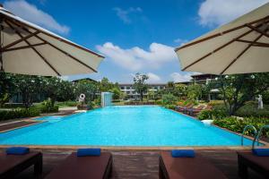 The swimming pool at or near i Tara Resort & Spa