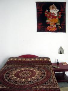 A bed or beds in a room at Friends in Khajuraho
