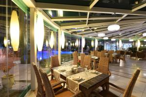 A restaurant or other place to eat at Poseidon Palace