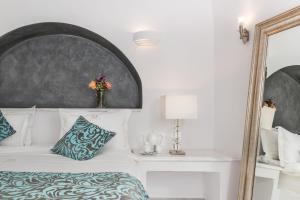 Un ou plusieurs lits dans un hébergement de l'établissement Anteliz Suites