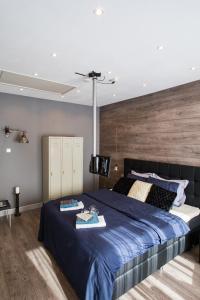 Een bed of bedden in een kamer bij Luxe B&B Het Colmerhof