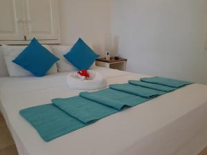 A bed or beds in a room at Bayahibe Guest House Hotel