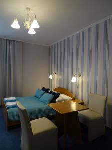 Łóżko lub łóżka w pokoju w obiekcie Hotel Piemont