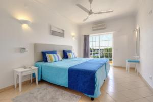 A bed or beds in a room at 3HB Clube Humbria - All Inclusive