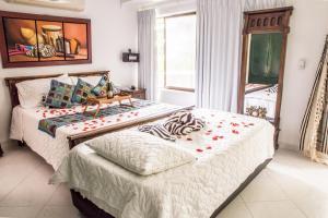 Cama o camas de una habitación en Hotel Campestre Villa Martha