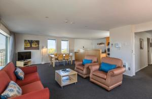 A seating area at Quest Christchurch Serviced Apartments