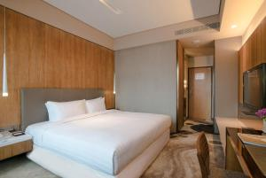 A bed or beds in a room at Home Hotel