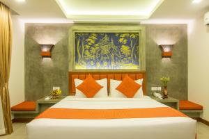 A bed or beds in a room at Chhay Long Angkor Boutique Hotel Siem Reap
