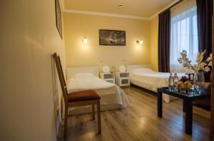 Кровать или кровати в номере Отель Ной Домодедово