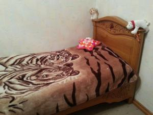 Кровать или кровати в номере Apartment on Zavenyagina 4
