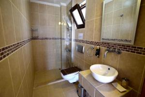 A bathroom at Truffle Residences