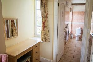 A bathroom at Waveney House Hotel