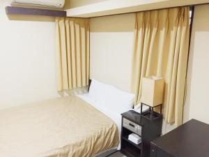 A bed or beds in a room at Nissei Hotel Fukuoka