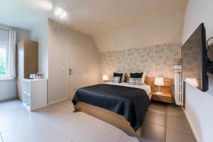 Un ou plusieurs lits dans un hébergement de l'établissement B&B Vis-à-Vis