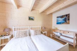 Ein Bett oder Betten in einem Zimmer der Unterkunft Bed & Breakfast Swiss Seasons