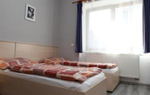Кровать или кровати в номере Penzion Markéta Chrudim