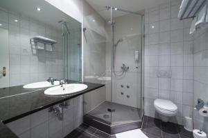 Ein Badezimmer in der Unterkunft Motel Fehraltorf