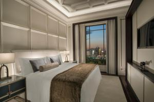 A bed or beds in a room at The St. Regis Astana