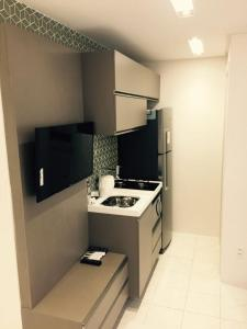 A kitchen or kitchenette at Flats Jaqueira Prime