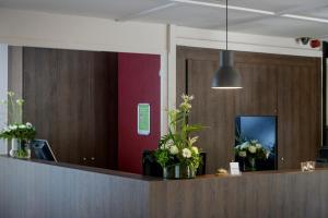 De lobby of receptie bij Campanile Gent