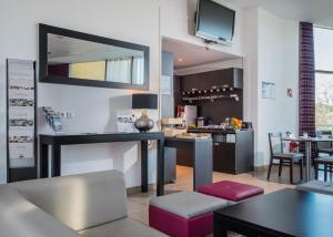 A kitchen or kitchenette at Néméa Appart'hotel Green side Biot Sophia Antipolis