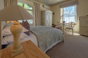 A bed or beds in a room at Auberge Clermont