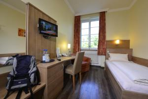 TV/Unterhaltungsangebot in der Unterkunft Hotel Haus Neugebauer BB