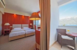 A bed or beds in a room at Marko Polo Hotel by Aminess