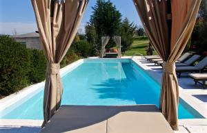 The swimming pool at or near Carmo's Boutique Hotel - Small Luxury Hotels of the World
