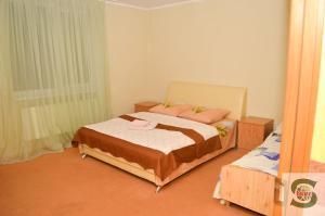 A bed or beds in a room at U Kvasu Hotel