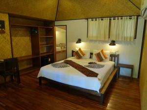 A bed or beds in a room at Relax Bay Resort