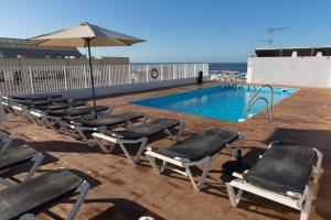 Het zwembad bij of vlak bij Marbella Inn