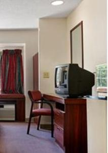 A television and/or entertainment center at Microtel Inn by Wyndham Spartanburg Duncan