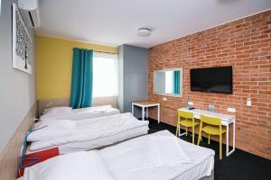 Łóżko lub łóżka w pokoju w obiekcie Tamada
