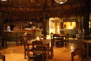 A restaurant or other place to eat at Posada y Pizzeria La Termita