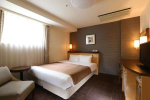 A bed or beds in a room at Hotel Hokke Club Sapporo