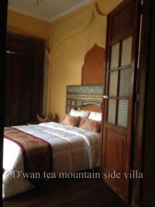 Ein Bett oder Betten in einem Zimmer der Unterkunft D'wan Tea Mountain Side