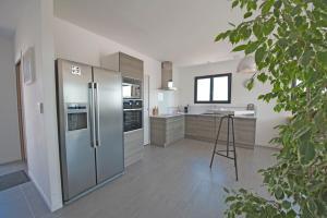 A kitchen or kitchenette at La Moulinière