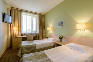 Кровать или кровати в номере Гостиница Скайпорт
