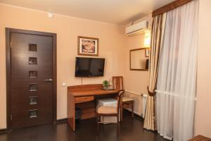 A television and/or entertainment center at Morion Hotel