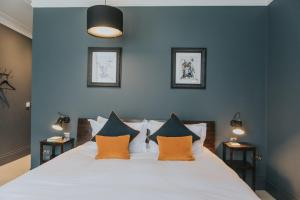 A bed or beds in a room at The Ginger Pig