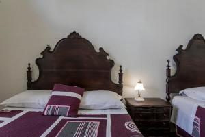 A bed or beds in a room at Veneza