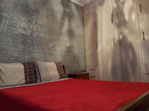 A bed or beds in a room at Sunny holiday home