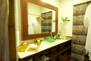 A bathroom at Japamala Resorts - By Samadhi