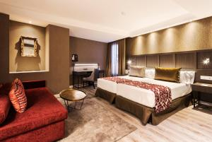 Cama o camas de una habitación en Catalonia Ronda