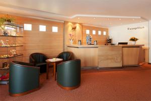 The lobby or reception area at Morada Hotel Isetal