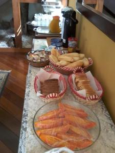 Breakfast options available to guests at Village Pendotiba