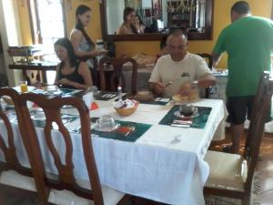A restaurant or other place to eat at Village Pendotiba