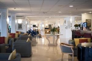 The lobby or reception area at Hotel Weber Ambassador