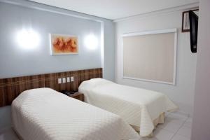 A bed or beds in a room at Serras Hotel